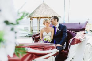 Bride and groom in the wedding carriage